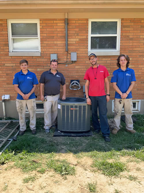 staff with outdoor ac unit